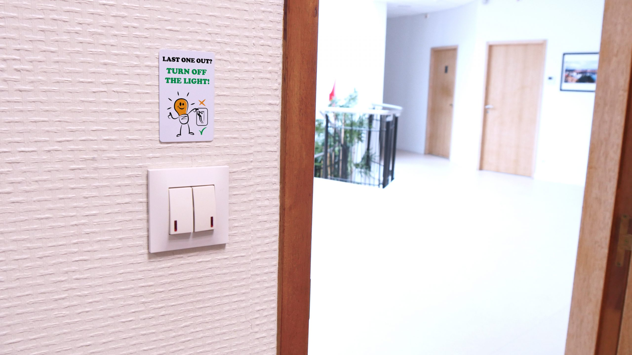 interior signage card to ask to turn off the light