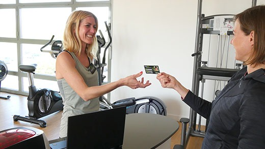 verification of membership card at the entrance of a gym